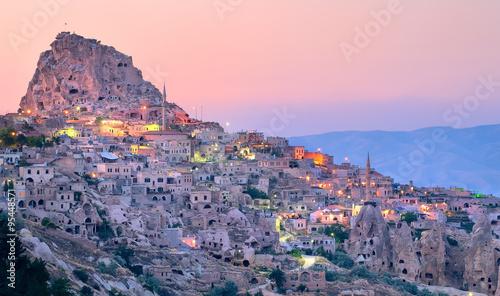Poster Turquie Uchisar cave city in Cappadocia, Turkey on sunset