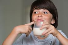 Young Boy Drinking Milk