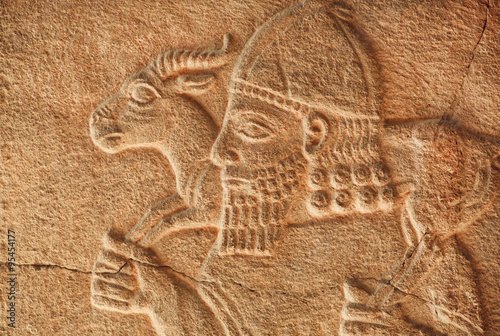 Fotomural Historical Assyrian relief of farmer with goat from Pergamon museum