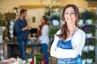 canvas print picture - Portrait Of Smiling Florist At Flower Shop
