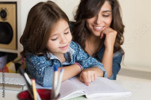 Valokuva  Mother helping child with homework