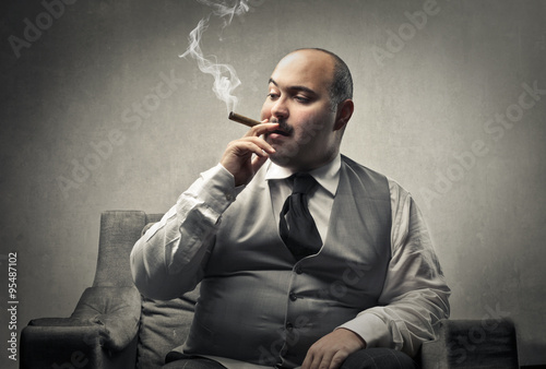 Fotografie, Tablou  Fat man smoking a cigar