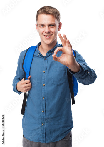 student man with back pack doing allright sign Canvas Print