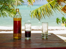 Drink With Rum And Cola At The Beach Of Roche Noir In Mauritius