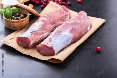 Photo  Raw pork tenderloin