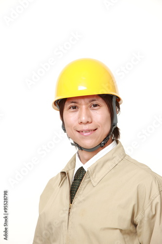 Fotografia  young Japanese construction worker smiles