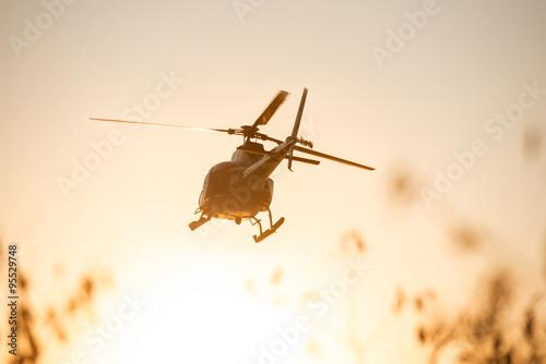 Türaufkleber Hubschrauber Passanger Helicopter flying in sunset sky
