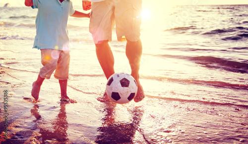 Fotografie, Obraz  Father Son Playing Soccer Beach Summer Concept