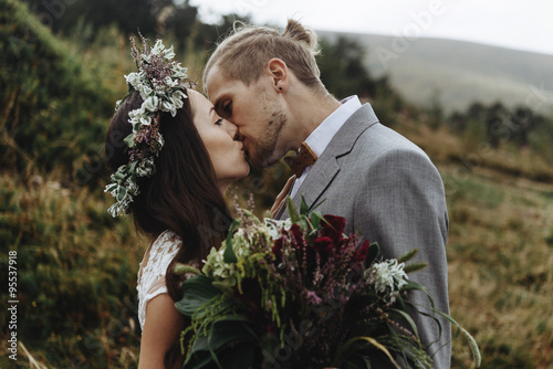 beautiful fabulous happy  bride with bouquet and wreath and styl