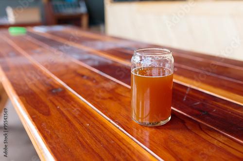 Photo  IPA Glass on Wood Table