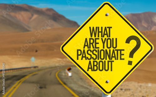 Photo  What Are You Passionate About? sign on desert road