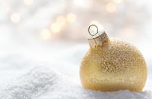 Golden Christmas Ball On Snow