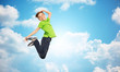 smiling boy jumping in air