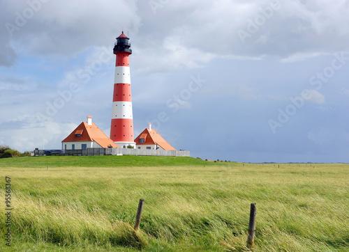 Foto op Aluminium Vuurtoren Leuchtturm am Meer - Westerhever Wahrzeichen an der Nordsee