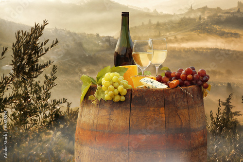 White wine with barrel on vineyard in Chianti, Tuscany, Italy - 95616514