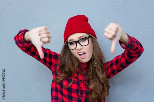 Obraz na plátně Woman showing thumbs down gesture