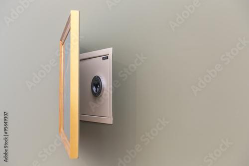 Photo  Hidden wall safe