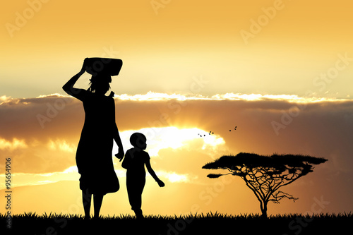 Fényképezés  African woman and son at sunset