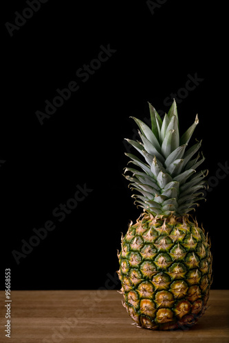 Fototapety, obrazy: Pineapple on a wooden table