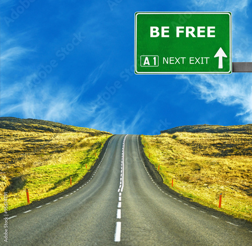 Photo  BE FREE road sign against clear blue sky