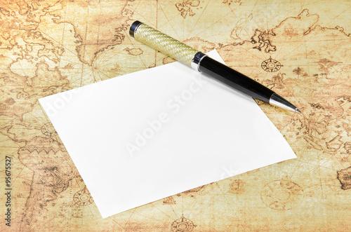 Paper and pen on a old world map – kaufen Sie dieses Foto und finden ...