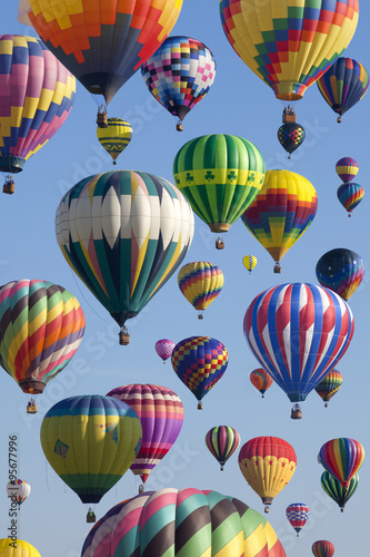 Fotografie, Obraz  The mass ascension launch of over 100 colorful hot air balloons at the New Jersey Ballooning Festival in White-house Station, New Jersey as a early morning race