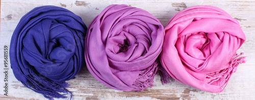 Fotografie, Obraz  Colorful scarves on old rustic wooden background