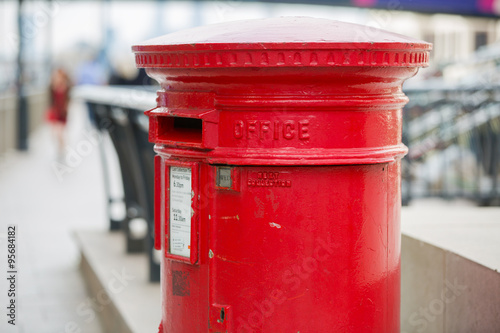 Fotografie, Tablou LONDON, UK - SEPTEMBER 14, 2015:  Royal mail red post box in Canary Wharf