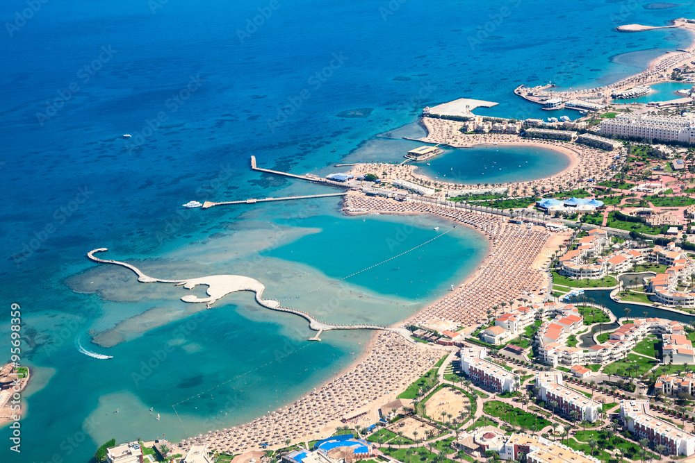 Fototapeta Sea bays with piers and locations enclosures for swimming and tanning, Egyptian resorts, aerial view, the Red Sea, Egypt