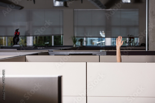 hand raised asking for help in office cubicle Fototapet