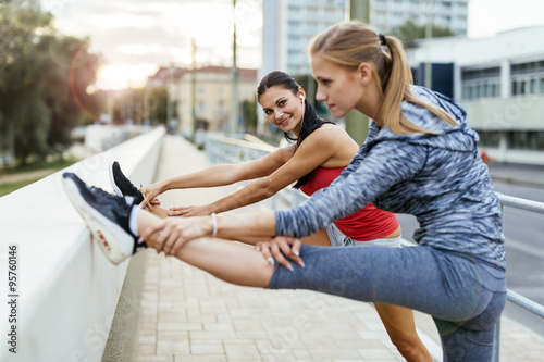 Two women stretching feet Wallpaper Mural