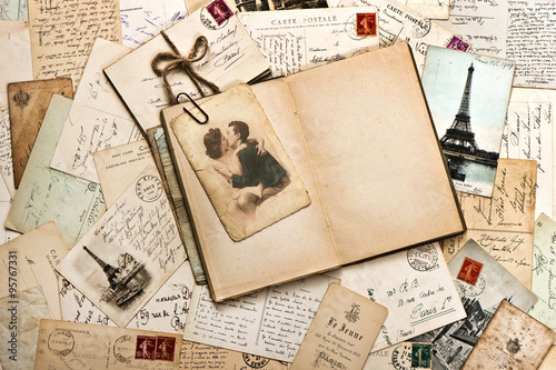 old papers, french post cards and open diary book Fotobehang