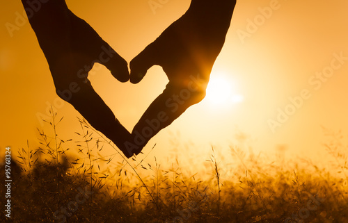 Fotografie, Obraz  Heart against beautiful sunset.