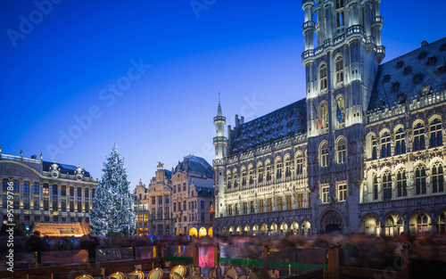 Poster Brussel Lights show in Grand Place of Brussels Belgium and a huge Christmas tree with a crowd of unidentified people enjoying the celebration atmosphere