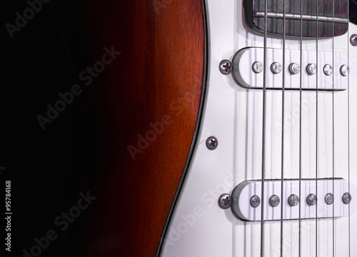 Photo  Electric guitar isolated on black background