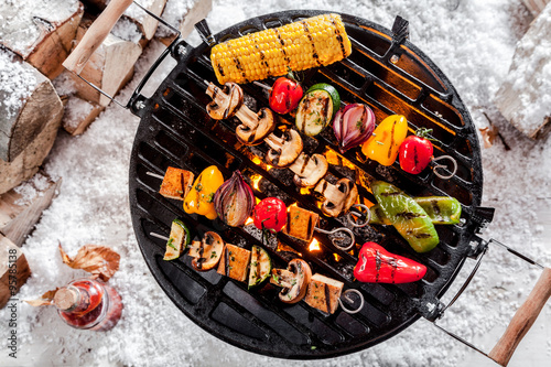 Aluminium Prints Grill / Barbecue Veggie kebabs grilling on a winter BBQ