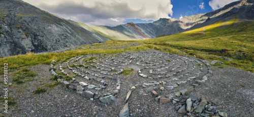 Tuinposter UFO Circles of stones in the mountains