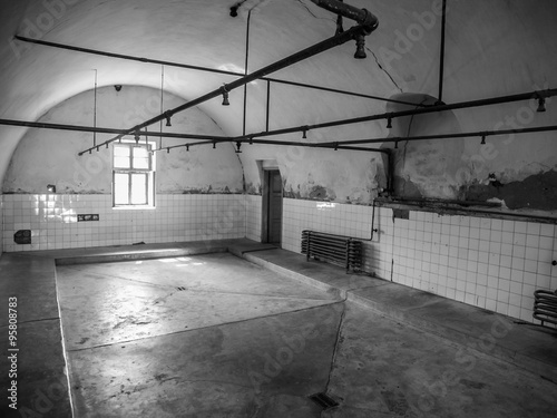 Interior of bathroom with showers in prison Canvas-taulu