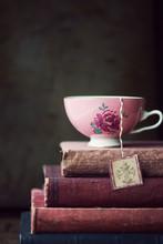 Vintage Teacup On Stack Of Old...