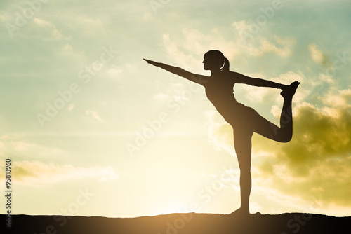 Stampe  Yoga silhouette outdoor at sunset