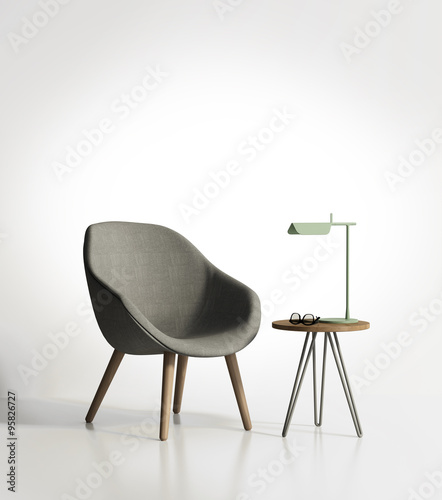Valokuva  Modern grey armchair with a light green lamp