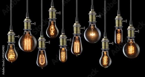 Papiers peints Retro Collection of vintage glowing light bulbs on black
