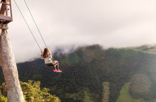 Silhouette Of Young Woman Caucasian On A Swing