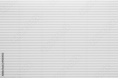 Foto  White corrugated paperboard texture as a background