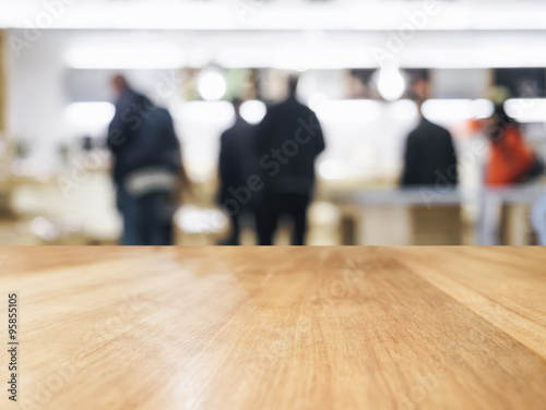 Staande foto Industrial geb. Table top with Blurred People and Shop interior background