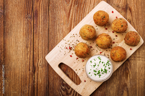 Fototapety, obrazy: Chickpea falafel balls on a wooden desk with vegetables