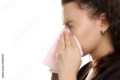 Fotografia, Obraz  the girl with the runny nose on a white isolated background