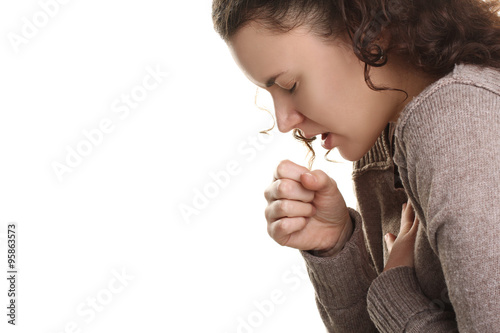 Fototapeta girl in a sweater with a cough on a white isolated background