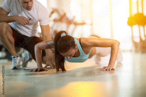Gym woman doing push ups