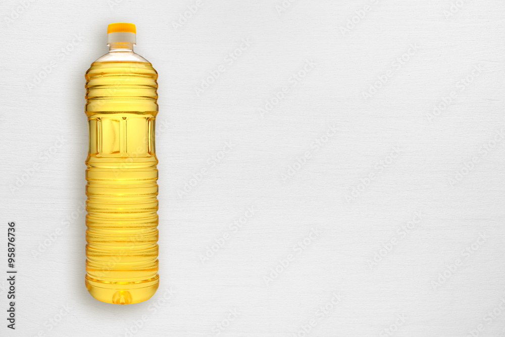 Fototapety, obrazy: Bottle of sunflower oil on white table